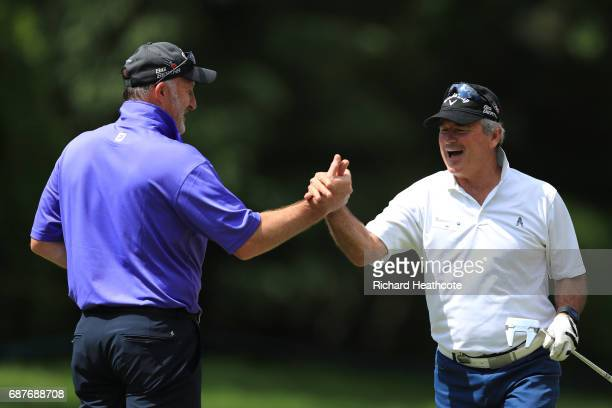 Allan Lamb celebrates with Alan McInally during the BMW PGA Championship ProAm at Wentworth on May 24 2017 in Virginia Water England