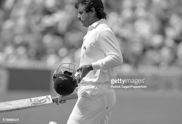 Allan Lamb of England walks off after being dismissed for 0 in the first innings of the 4th Test match between Australia and England at Adelaide...