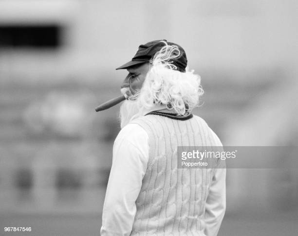 Allan Lamb of Northamptonshire wears a fancy dress mask during a County Championship match between Essex and Northamptonshire at the County Ground on...