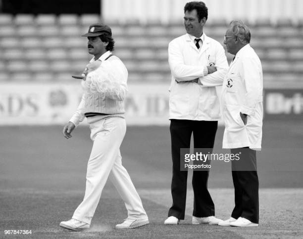 Allan Lamb of Northamptonshire with a fancy dress mask during a County Championship match between Essex and Northamptonshire at the County Ground on...