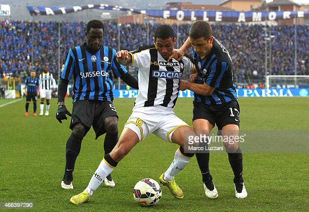 Allan Marques Loureiro of Udinese Calcio competes for the ball with Carlos Carmona and Boukary Drame of Atalanta BC during the Serie A match between...