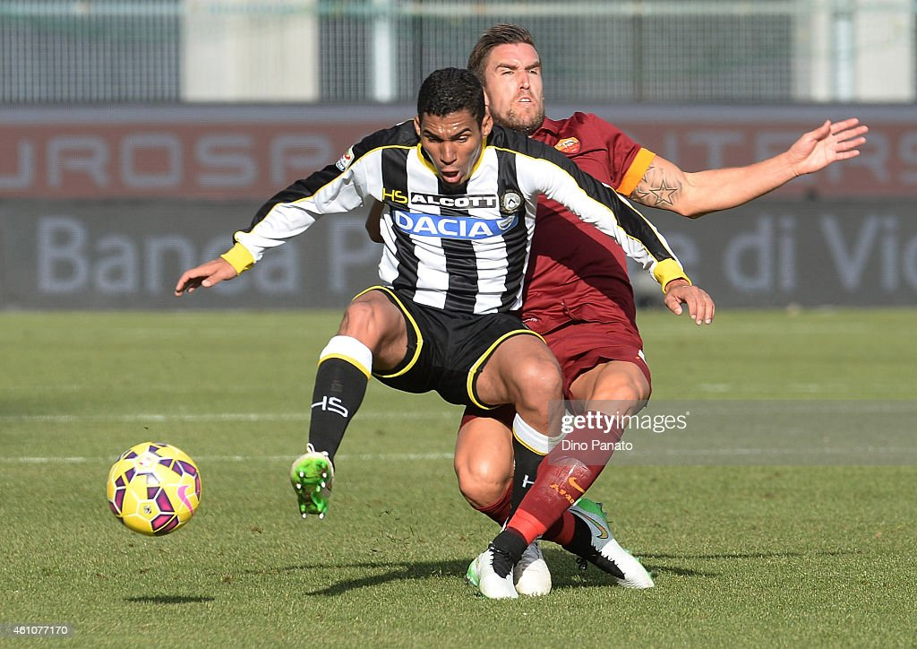 Allan Marques Loureiro (L) of Udinese Calcio competes with Kostas Manolas of AS Roma during the Serie A match between Udinese Calcio and AS Roma at Stadio Friuli on January 6, 2015 in Udine, Italy.