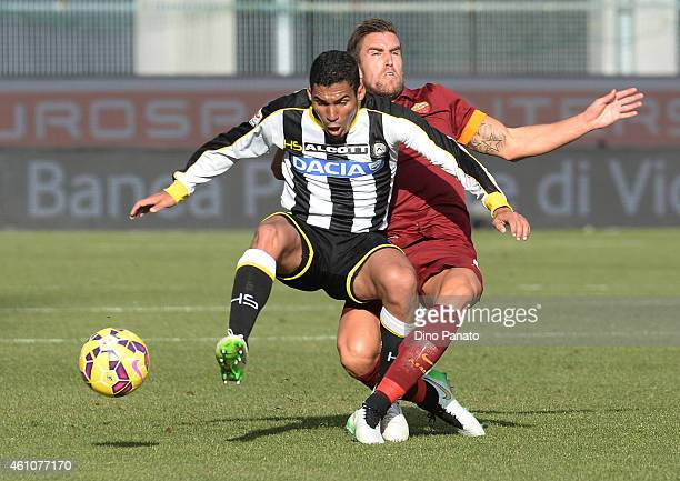 Allan Marques Loureiro of Udinese Calcio competes with Kostas Manolas of AS Roma during the Serie A match between Udinese Calcio and AS Roma at...