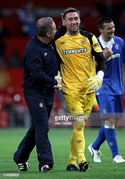 Allan McGregor of Rangers is congratulated by Assistant Manager Ally McCoist at the end of the UEFA Champions League Group C match between Manchester...