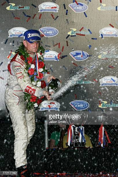 Allan McNish, driver of the Audi Sport North America Audi AG R10/TDI, celebrates in victory lane after winning the 10th Anniversary Petit Le Mans at...