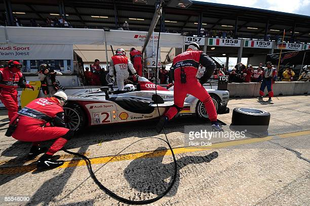 Allan McNish takes over driving duties from Tom Kristensen in the Audi Sport Team Joest Audi R15 during the 57th Annual Mobil1 12 Hours of Sebring at...