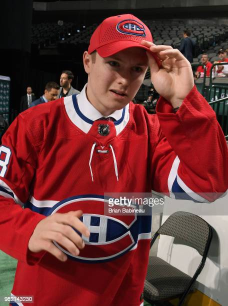 Allan McShane adjusts his cap after being selected 97th overall by the Montreal Canadiens during the 2018 NHL Draft at American Airlines Center on...