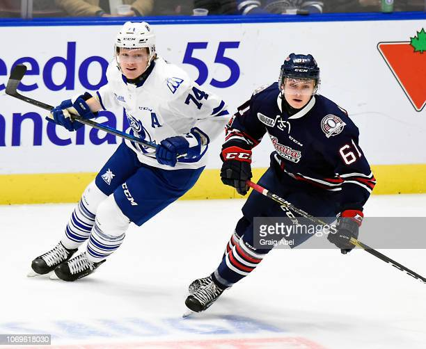 Allan McShane of the Oshawa Generals skates up ice against Owen Tippett of the Mississauga Steelheads during OHL game action on December 7 2018 at...