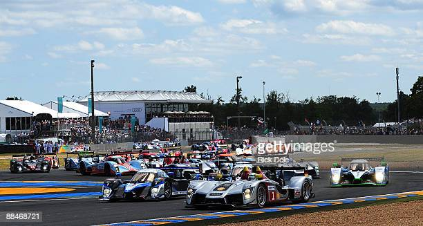 Allan NcNish in the Audi Sport Team Joest Audi R15 and Franck Montagny in the Team Peugeot Total Peugeot 908 lead the field for start of the 77th...
