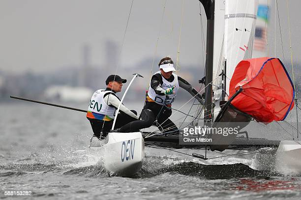 Allan Norregaard of Denmark and Anette Viborg of Denmark compete in the Nacra 17 Mixed class on Day 5 of the Rio 2016 Olympic Games at the Marina da...