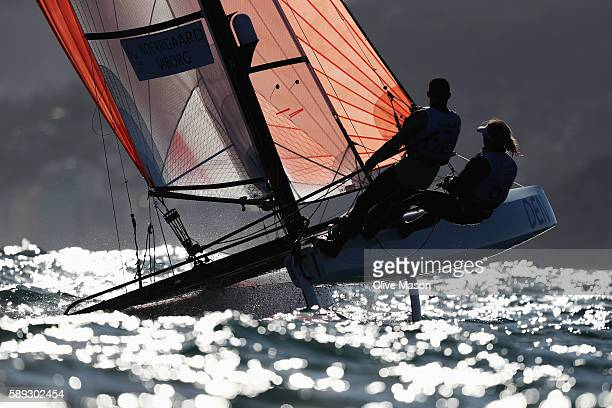 Allan Norregaard of Denmark and Anette Viborg of Denmark compete in the Nacra 17 Mixed class on Day 8 of the Rio 2016 Olympic Games at the Marina da...