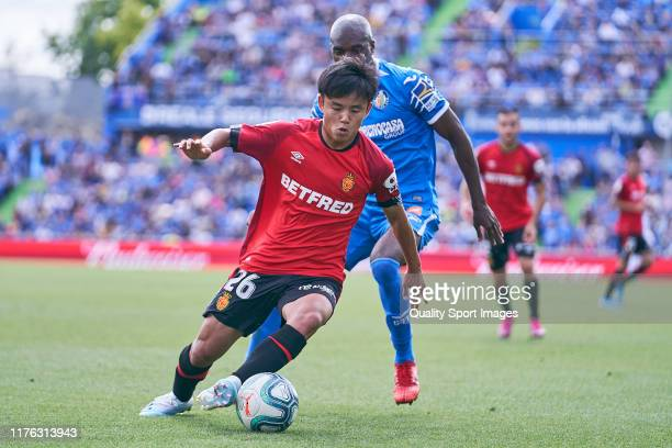 Allan Nyom of Getafe CF battle for the ball with Kubo of RCD Mallorca during the La Liga match between Getafe CF and RCD Mallorca at Coliseum Alfonso...