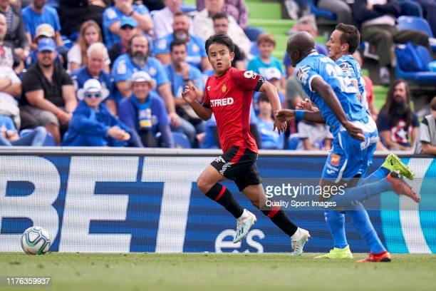 Allan Nyom of Getafe CF battle for the ball with Take Kubo of RCD Mallorca during the La Liga match between Getafe CF and RCD Mallorca at Coliseum...