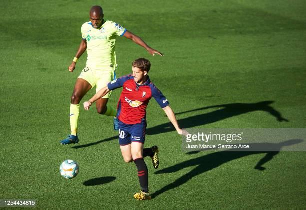 Allan Nyom of Getafe CF duels for the ball with Darko Brasanac of CA Osasuna during the Liga match between CA Osasuna and Getafe CF at on July 05...