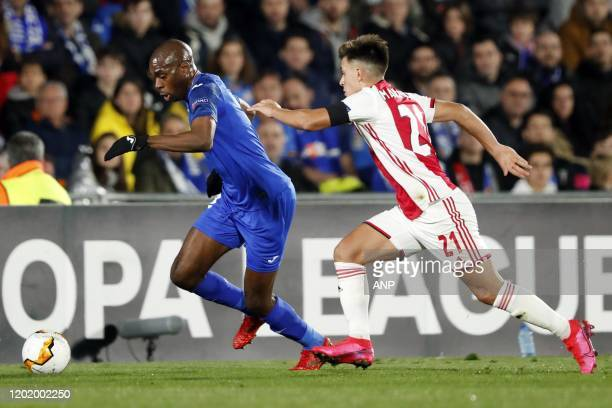 Allan Nyom of Getafe CF Lisandro Martinez of Ajax during the UEFA Europa League round of 32 first leg match between Getafe CF and Ajax Amsterdam at...
