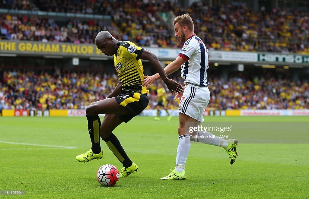 Allan Nyom of Watford and James Morrison of West Bromwich Albion during the Barclays premier League match between Watford and West Bromwich Albion at Vicarage Road on August 15, 2015 in Watford, England.