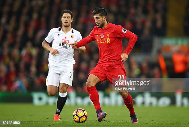 Allan Nyom of Watford closes down Emre Can of Liverpool during the Premier League match between Liverpool and Watford at Anfield on November 6 2016...