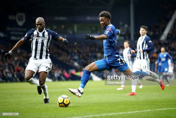 Allan Nyom of West Bromwich Albion and Demarai Gray of Leicester City battle for the ball during the Premier League match between West Bromwich...