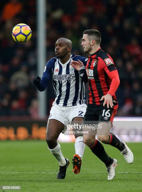 Allan Nyom of West Bromwich Albion and Lewis Cook of AFC Bournemouth battle for the ball during the Premier League match between AFC Bournemouth and...