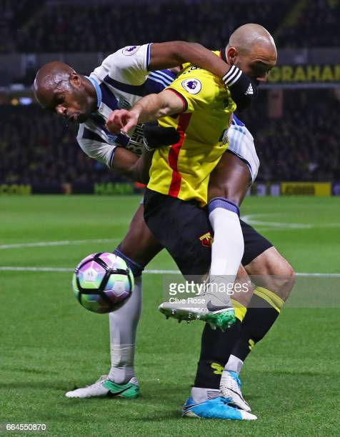 Allan Nyom of West Bromwich Albion and Nordin Amrabat of Watford battle for possession during the Premier League match between Watford and West...