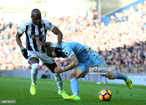 Allan Nyom of West Bromwich Albion fouls Marko Arnautovic of Stoke City during the Premier League match between West Bromwich Albion and Stoke City...