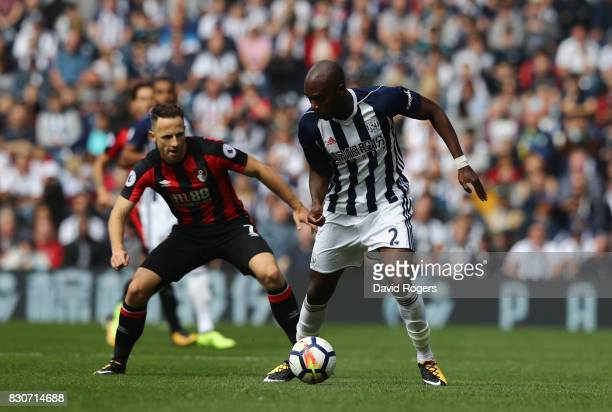 Allan Nyom of WestBromwich Albion is put under pressure from Marc Pugh of AFC Bournemouth during the Premier League match between West Bromwich...