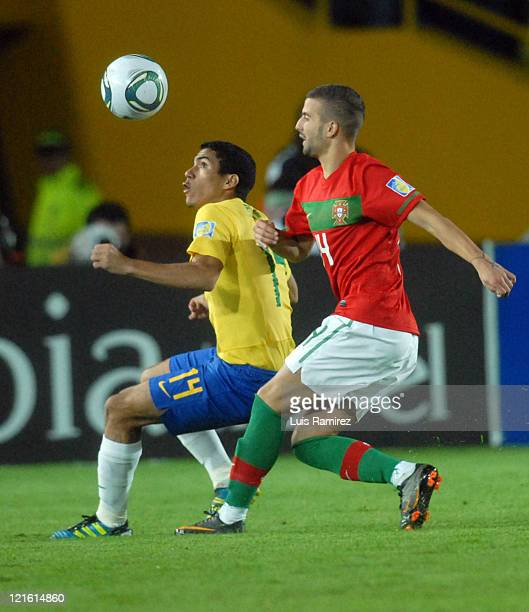 Allan of Brasil fight for the ball with Alex of Portugal during a match for the final between Brasil and Portugal as part of the FIFA U20 World Cup...