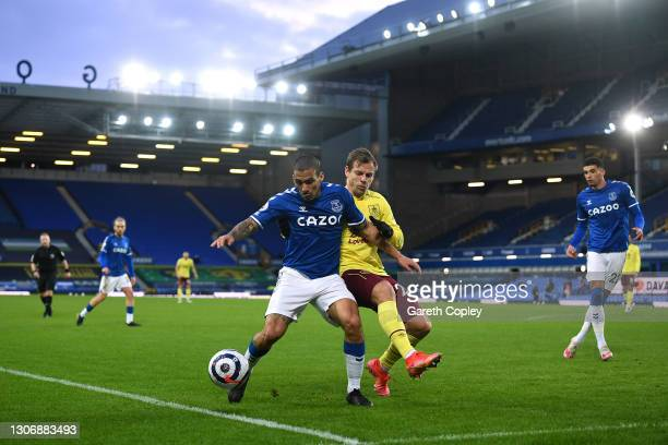 Allan of Everton battles for possession with Matej Vydra of Burnley during the Premier League match between Everton and Burnley at Goodison Park on...