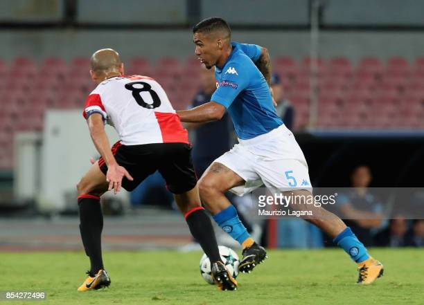 Allan of Napoli competes for the ball with Karim El Ahmadi of Feyenoord during the UEFA Champions League group F match between SSC Napoli and...
