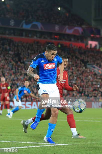 Allan of Napoli miskicks his clearance next to Georginio Wijnaldum of Liverpool during the UEFA Champions League group E match between Liverpool FC...