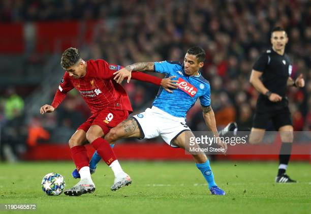 Allan of Napoli tackles Roberto Firmino of Liverpool during the UEFA Champions League group E match between Liverpool FC and SSC Napoli at Anfield on...