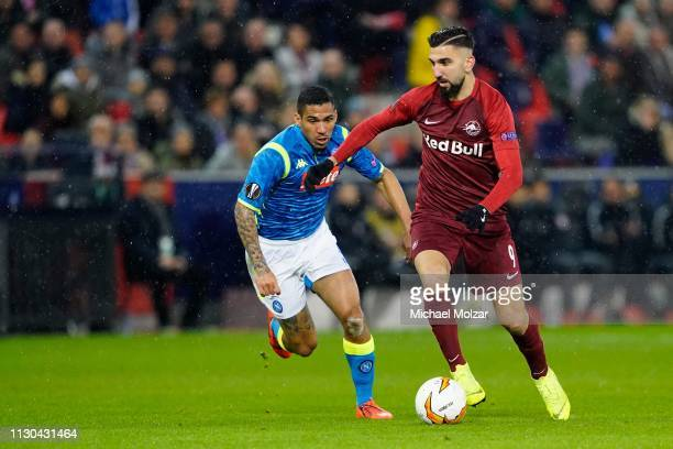 Allan of SSC Napoli and Munas Dabbur of Salzburg during the UEFA Europa League Round of 16 match between FC Salzburg and SSC Napoli at Red Bull Arena...