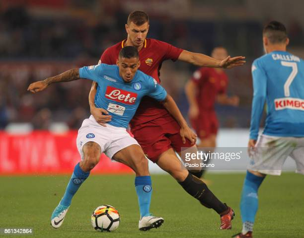 Allan of SSC Napoli competes for the ball with Edin Dzeko of AS Roma during the Serie A match between AS Roma and SSC Napoli at Stadio Olimpico on...