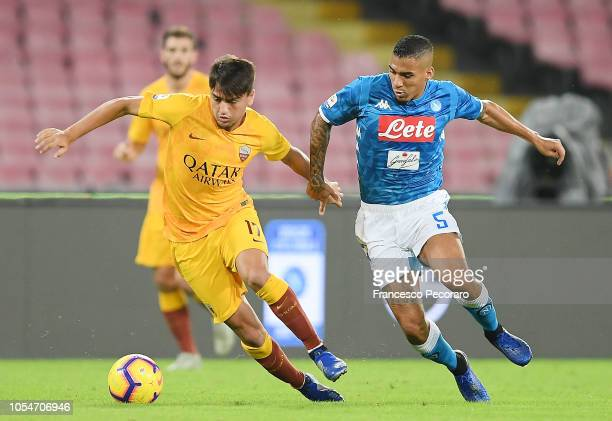 Allan of SSC Napoli fights for the ball with Cengiz Under of AS Roma during the Serie A match between SSC Napoli and AS Roma at Stadio San Paolo on...