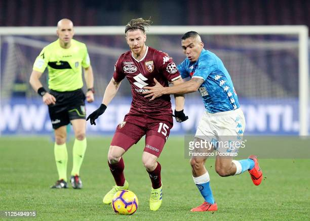 Allan of SSC Napoli vies Cristian Ansaldi of Torino FC during the Serie A match between SSC Napoli and Torino FC at Stadio San Paolo on February 17...