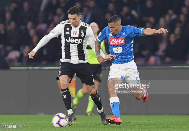 Allan of SSC Napoli vies Cristiano Ronaldo of Juventus during the Serie A match between SSC Napoli and Juventus at Stadio San Paolo on March 3 2019...
