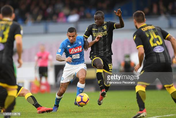 Allan of SSC Napoli vies Raman Chibsah of Frosinone Calcio during the Serie A match between SSC Napoli and Frosinone Calcio at Stadio San Paolo on...