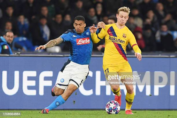 Allan of SSC Napoli vies with Frenkie de Jong of FC Barcelona during the UEFA Champions League round of 16 first leg match between SSC Napoli and FC...