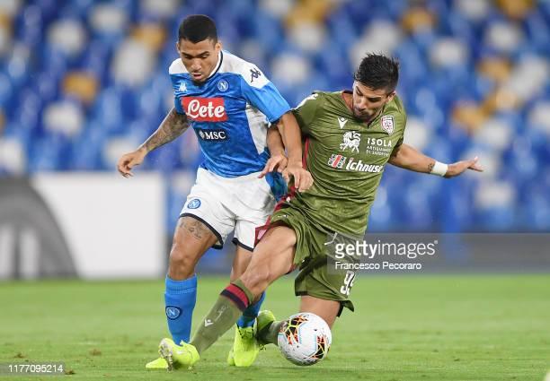 Allan of SSC Napoli vies with Giovanni Simeone of Cagliari Calcio during the Serie A match between SSC Napoli and Cagliari Calcio at Stadio San Paolo...