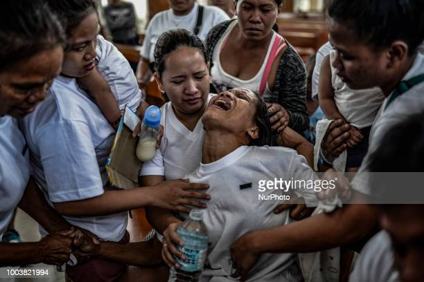 Allan Pineda weeps inconsolably during the funeral of her 13yearold son Aldrin who was shot to death by a police officer in Manila Philippines March...