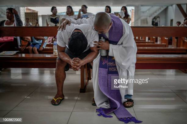 Allan Pineda weeps inconsolably during the funeral of his 13yearold son Aldrin who was shot to death by a police officer in Manila Philippines March...