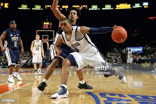 Allan Ray of the Villanova Wildcats drives against Ronald Ramon of the Pittsburgh Panthers during the semifinals of the Big East Men's Basketball...
