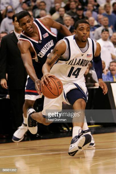 Allan Ray of the Villanova Wildcats drives against Rudy Gay of the Connecticut Huskies on February 13, 2006 at the Wachovia Center in Philadelphia,...