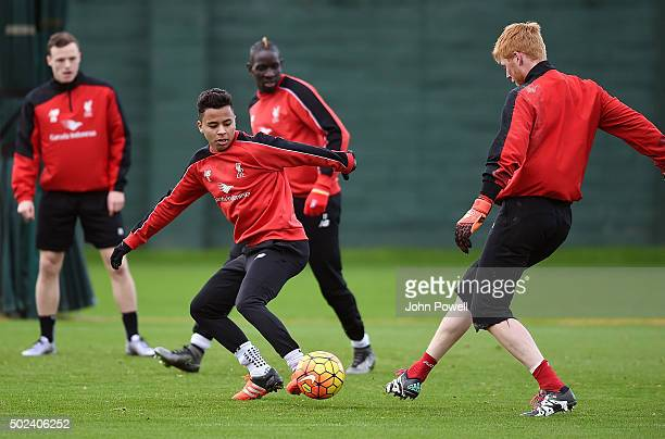 Allan Rodrigues de Souza and Adam Bogdan during a training session at Melwood Training Ground on December 24 2015 in Liverpool England