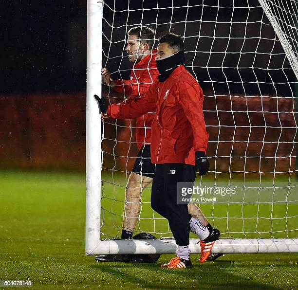 Allan Rodrigues de Souza and Jordan Henderson of Liverpool move the goal during a training session at Melwood Training Ground on January 12 2016 in...