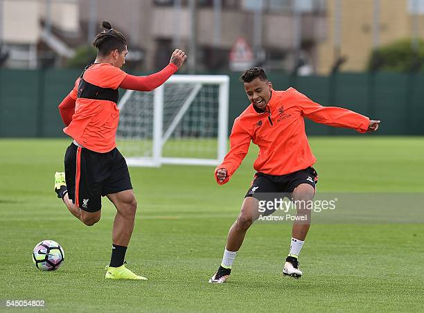 Allan Rodrigues De Souza and Roberto Firmino of Liverpool duringa training session at Melwood Training Ground on July 5 2016 in Liverpool England