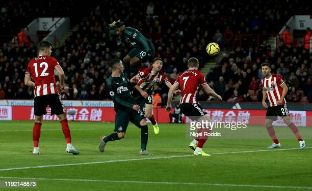 Allan Saint Maximin of Newcastle heads the opening goal during the Premier League match between Sheffield United and Newcastle United at Bramall Lane...