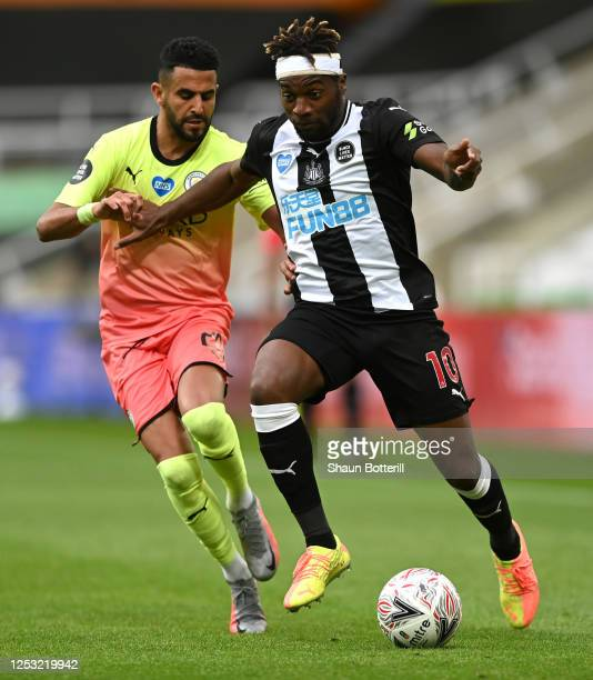 Allan Saint Maximin of Newcastle United is challenged by Riyad Mahrez of Manchester City during the FA Cup Quarter Final match between Newcastle...
