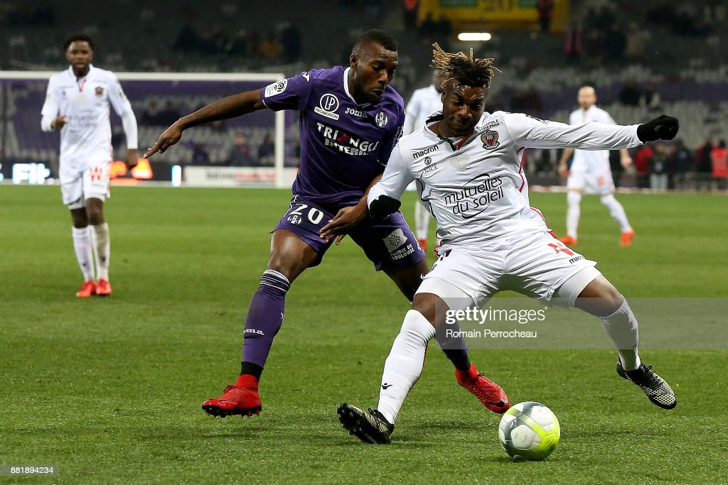 Allan Saint Maximin of Nice battle for the ball with Steeve Yago of Toulouse during the Ligue 1 match between Toulouse and OGC Nice at Stadium Municipal on November 29, 2017 in Toulouse, .