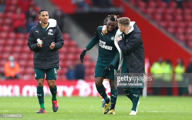 Allan SaintMaximin and Matt Ritchie of Newcastle United celebrate following their sides victory in the Premier League match between Southampton FC...